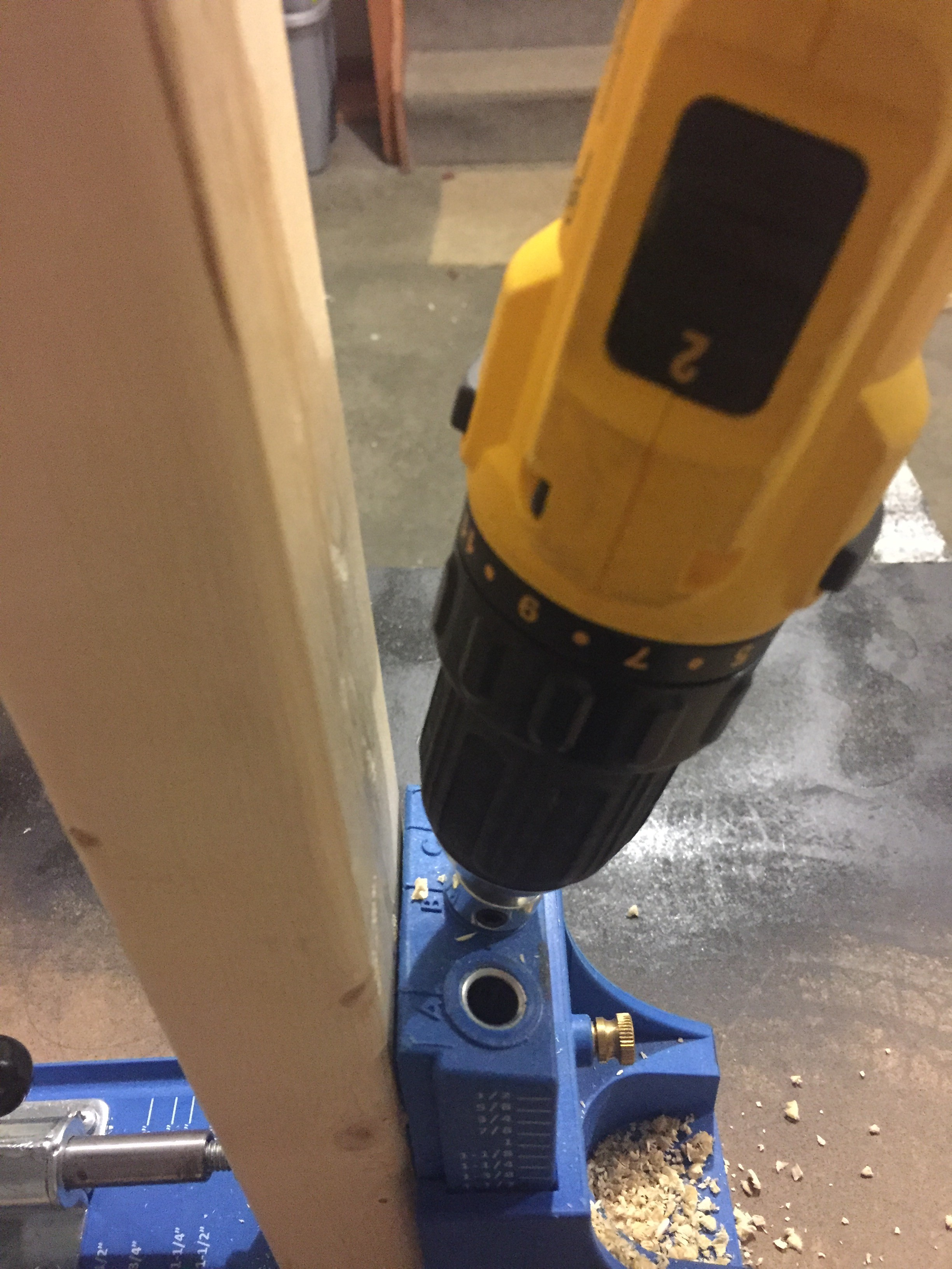 drilling into a kreg jig into a 2x4