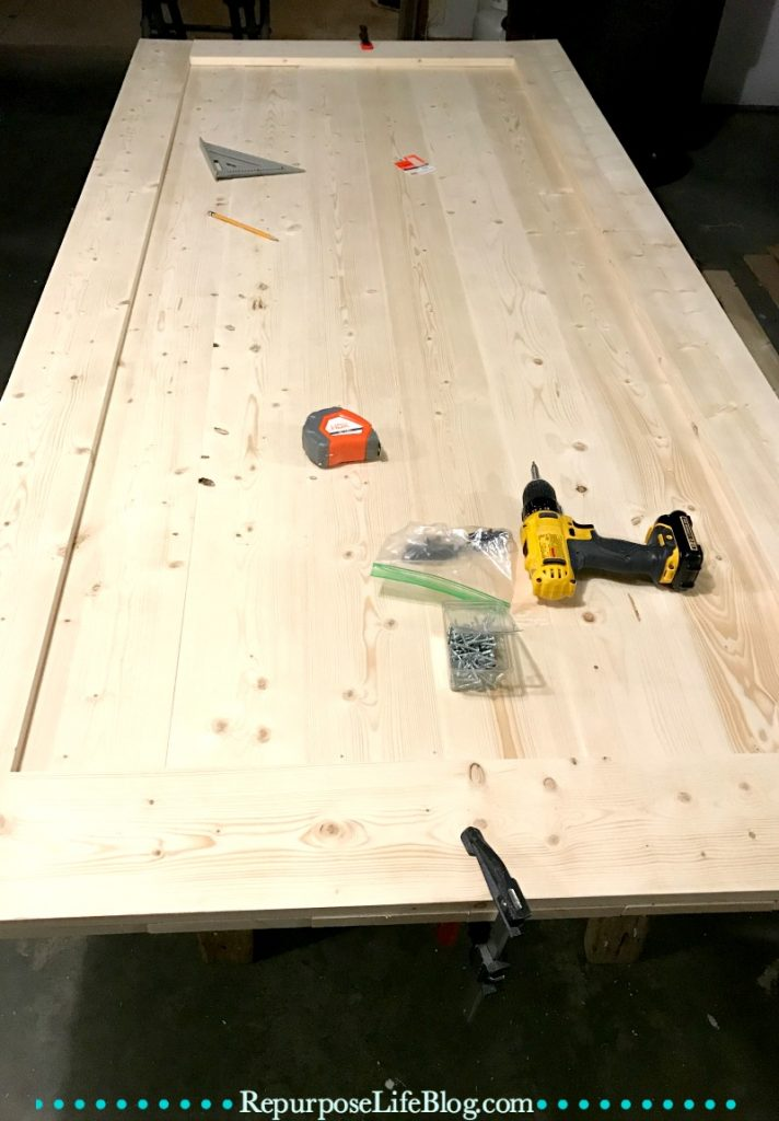A simple step-by-step how to make a sliding barn door.
