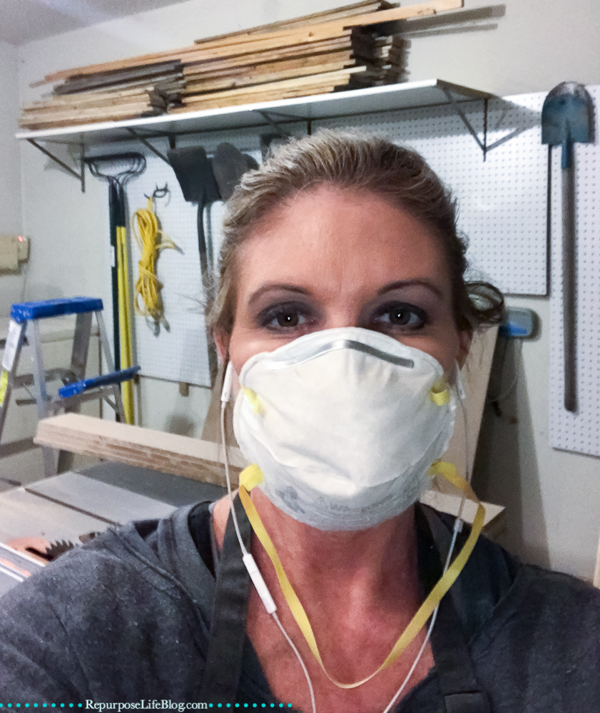 Lady with a safety mask on to avoid breathing in sawdust