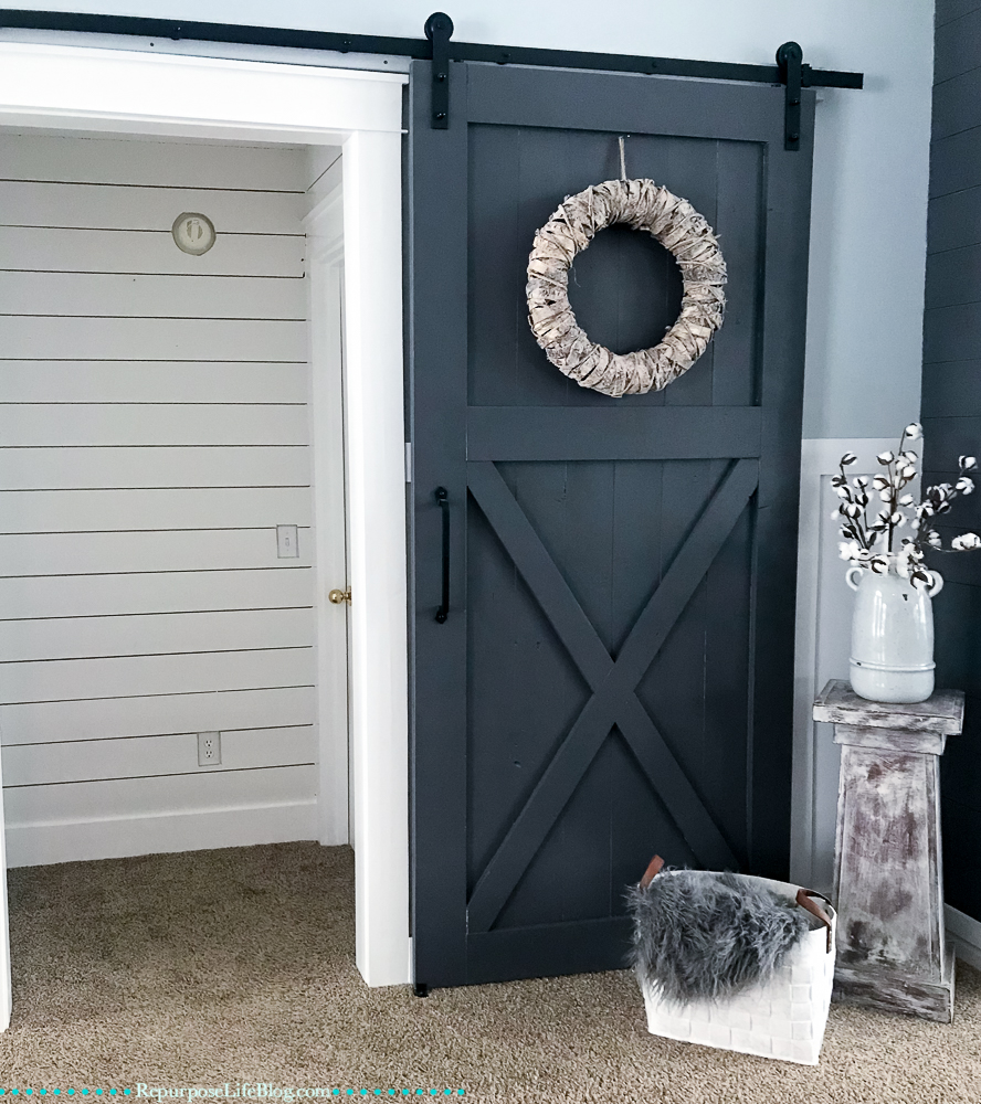 alcove with black sliding barn door