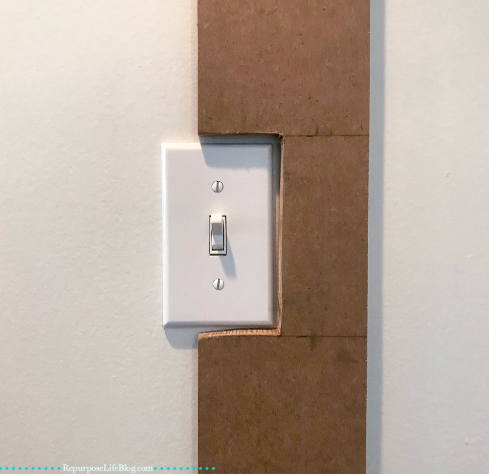 light switch with batten cut around it