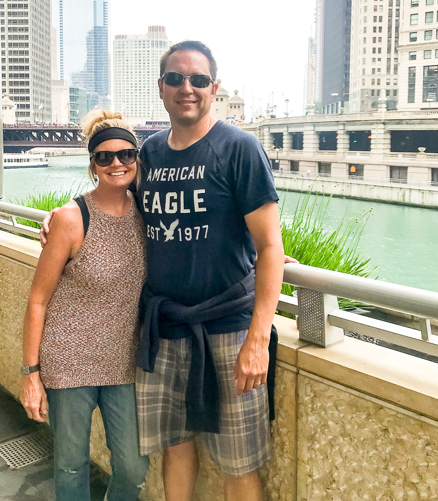 Happy couple posing for picture by the Chicago River
