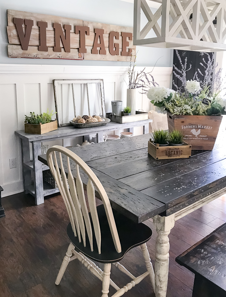 dining room table with large word sign in background