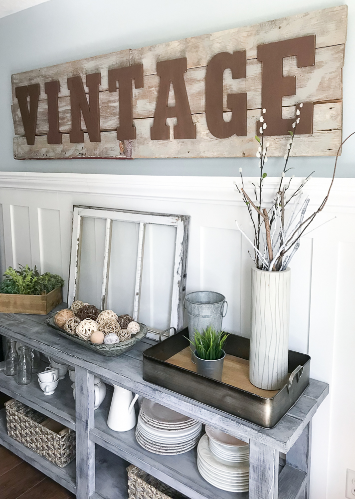 dining room with home decor and large word sign