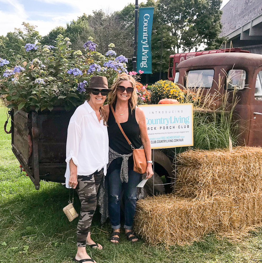 Mom and daughter in front of vintage truck
