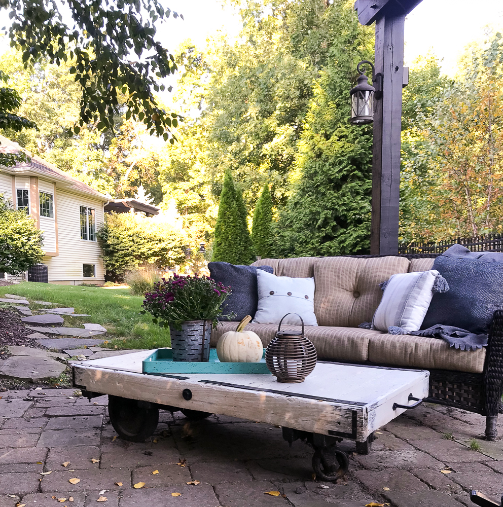 outdoor space under a pergola decorated for fall