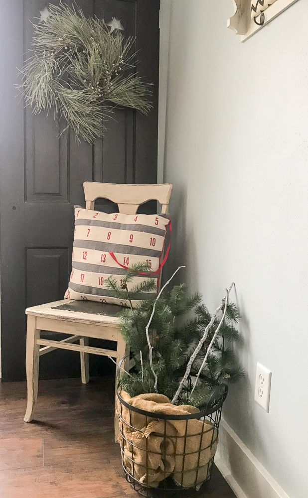 corner of dining room with chair and christmas decor