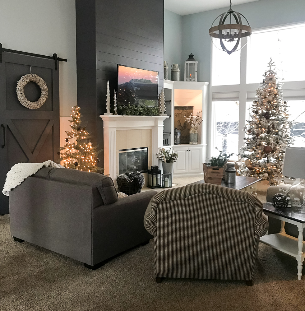 family room with christmas tree