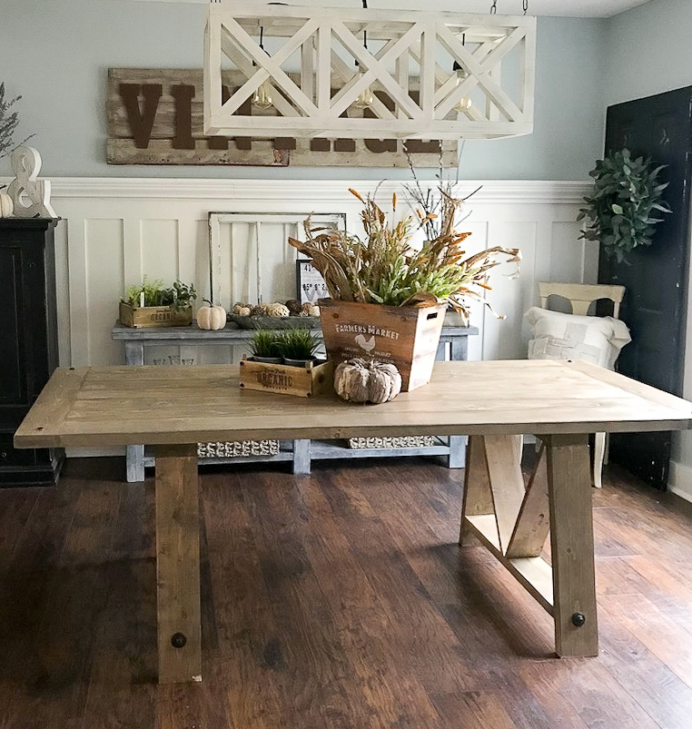 farmhouse table in dining room with fall decor