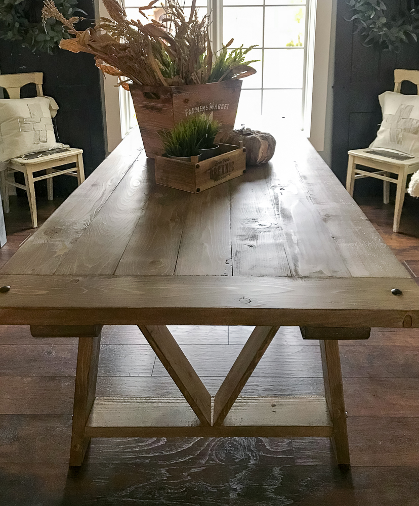 farmhouse table with fall decor on it