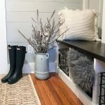 mudroom with boots and decor