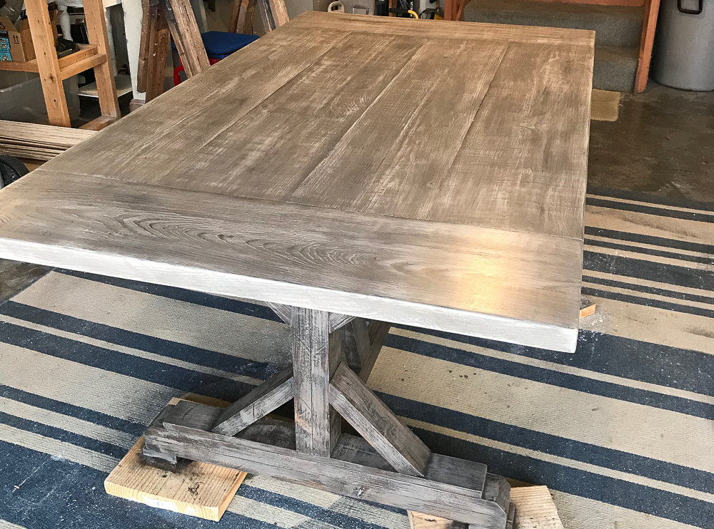 farmhouse table with breadboards
