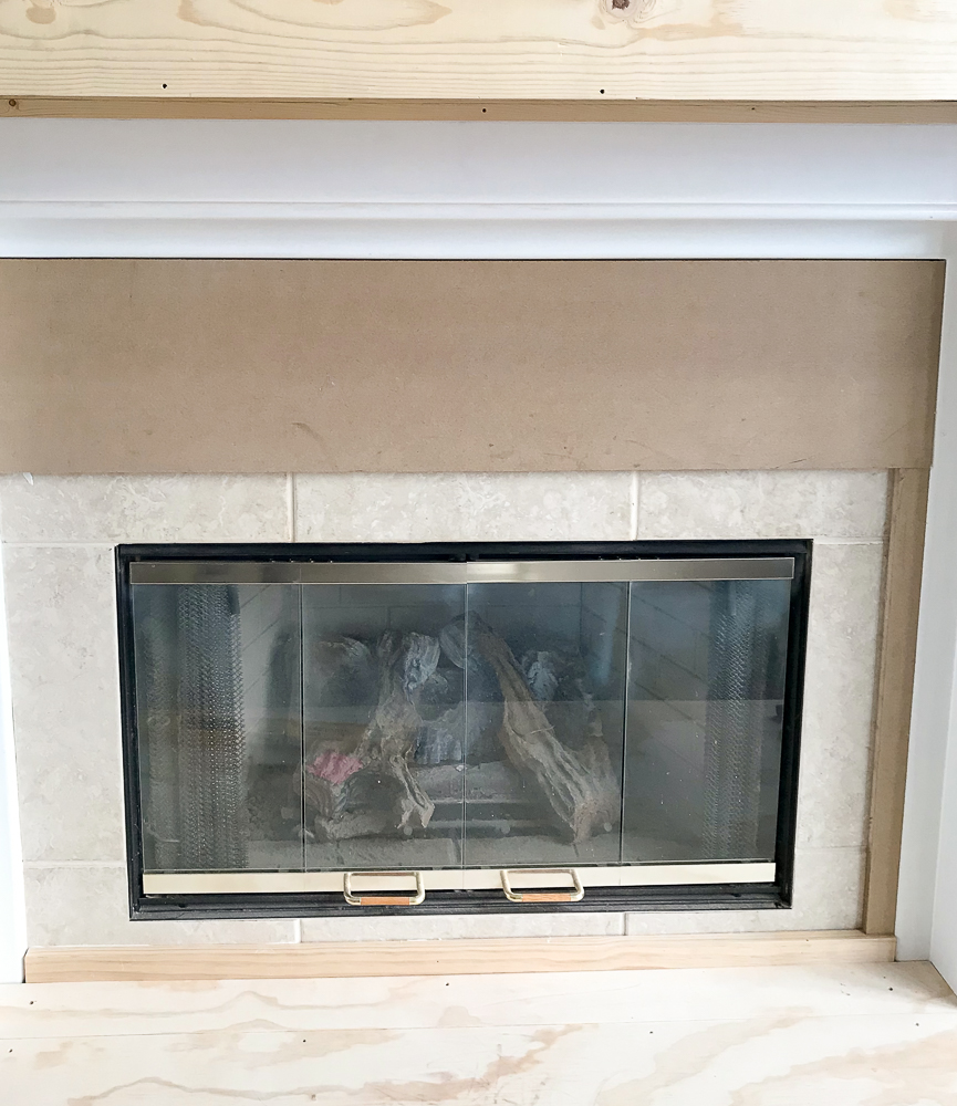 MDF board covering fireplace tile