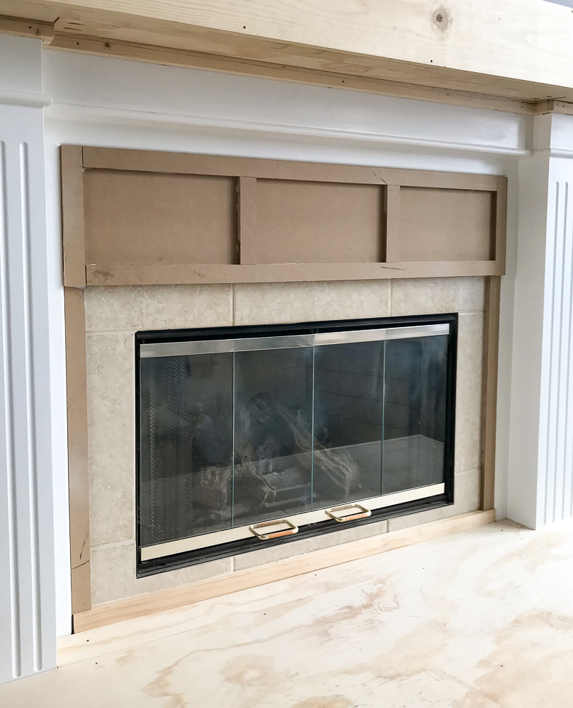trim added to fireplace makeover