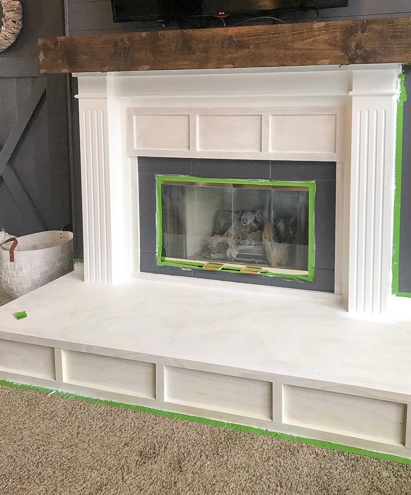 fireplace taped off for paint