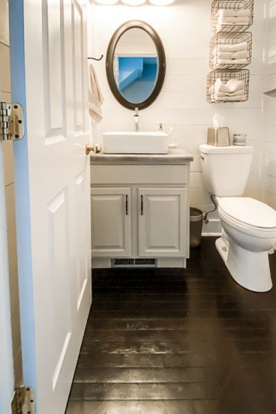 guest bathroom with restained hardwood floors