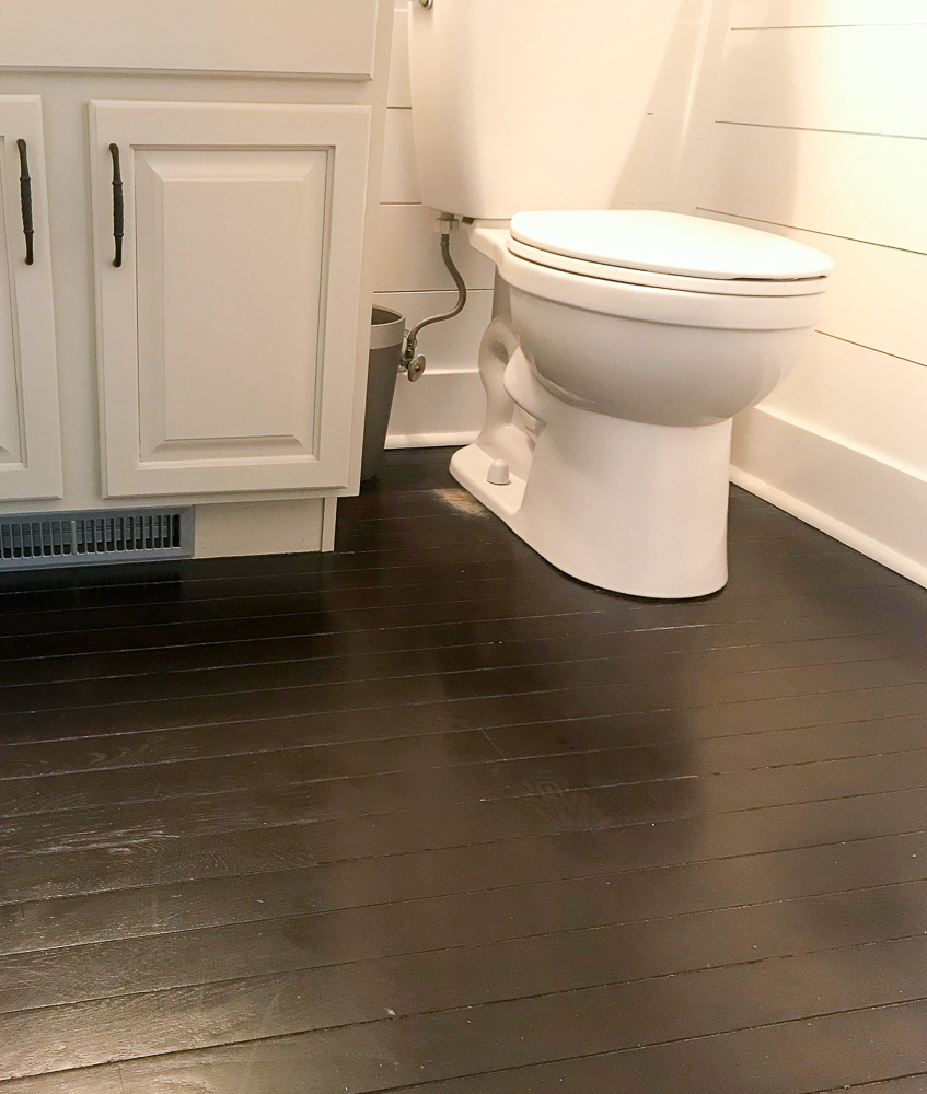toilet with restained hardwood floors