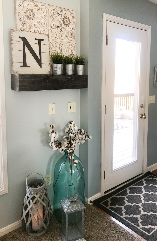 spring decor on floating shelves