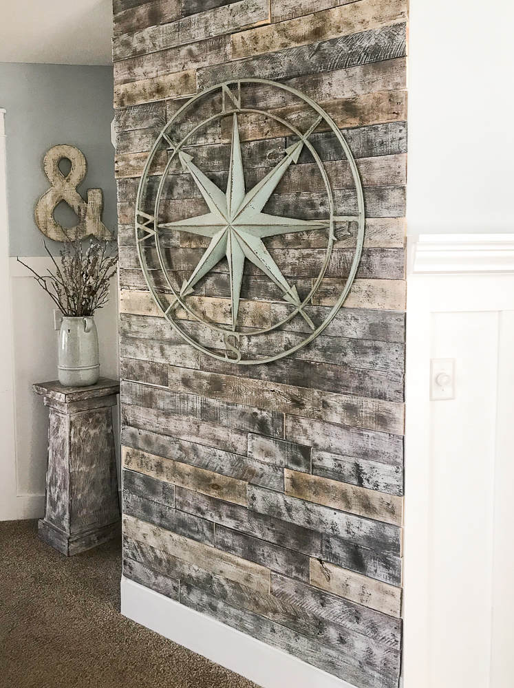 shiplap wall with large compass