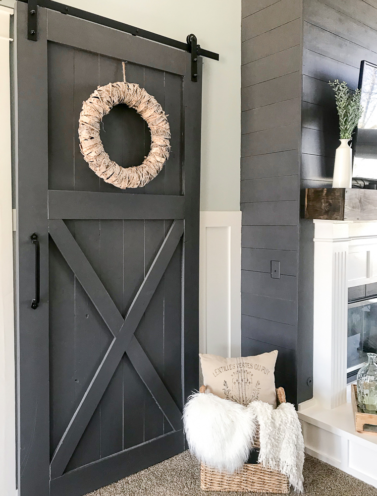 sliding barn door with pillows basket