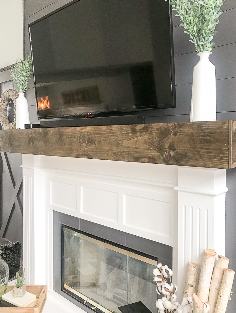 fireplace makeover with faux wood beam