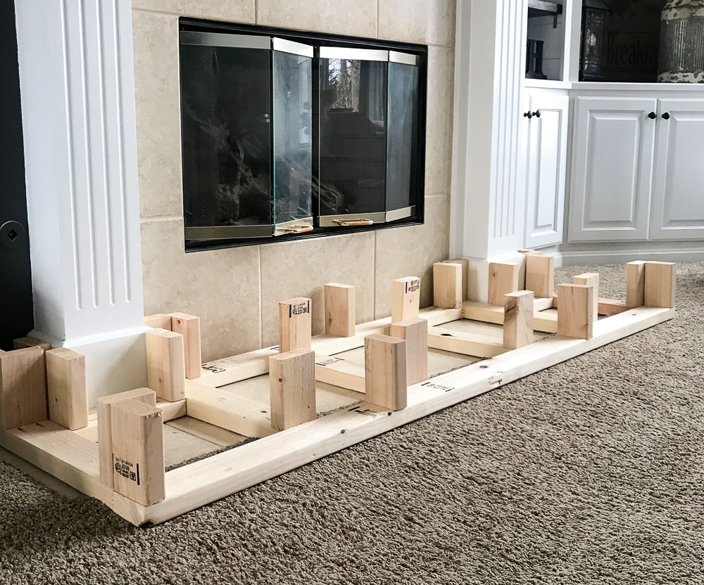 support for hearth with risers