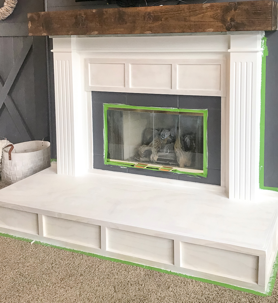 fireplace painted with primer and gray paint