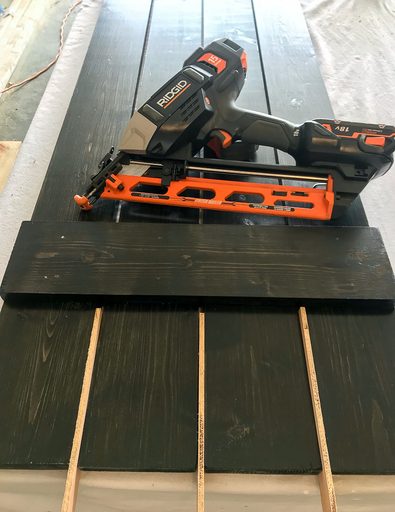 boards separated with paint sticks and one of my favorite tools, nailgun