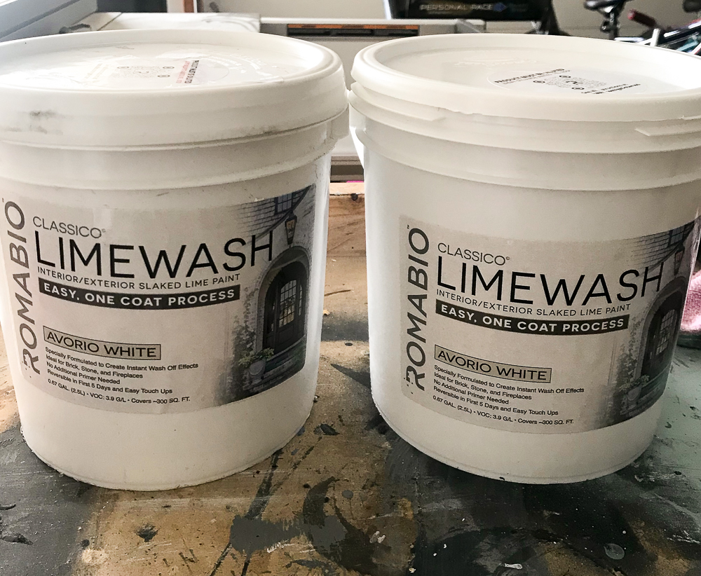 two limewash containers