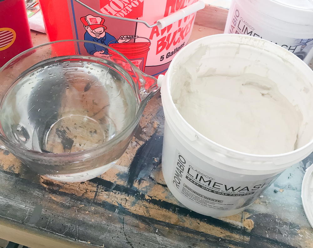 limewash and measuring cup of water
