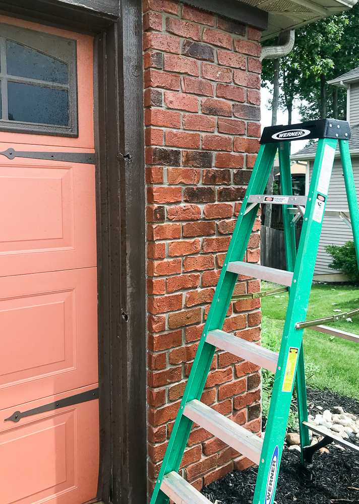ladder with a brick wall