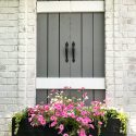 faux window with flower box and pink flowers