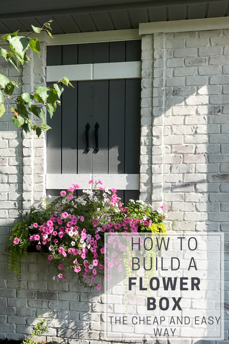 pinterest pin with how to build a flower box writing, faux window, pink flowers in window box, limwashed brick