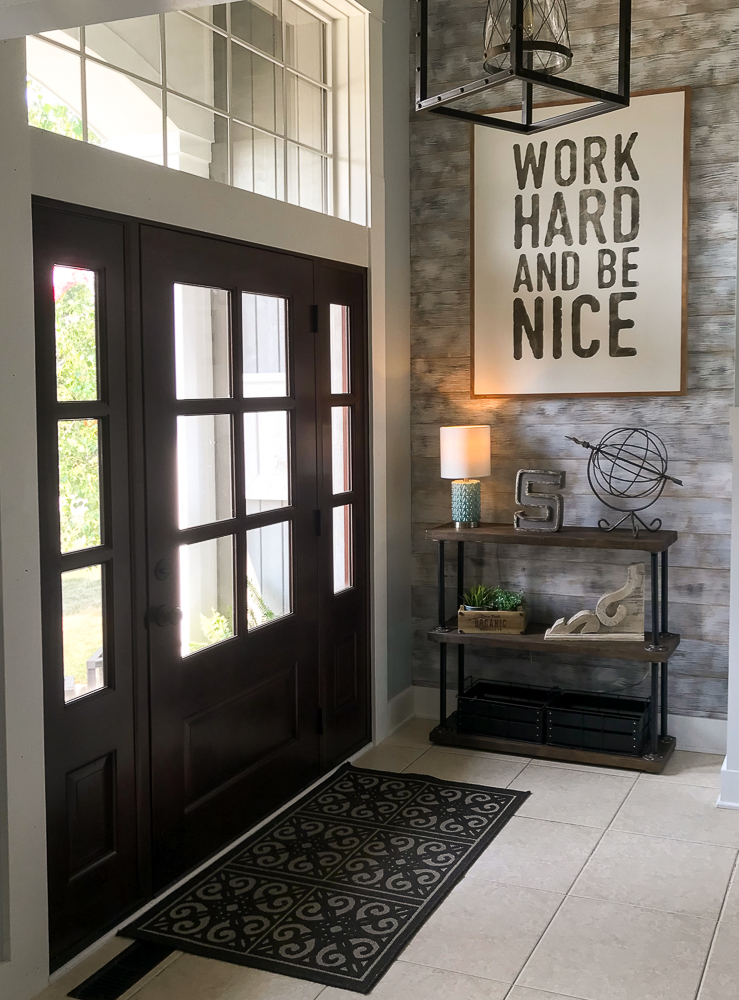 foyer with large sign, shelves and decor