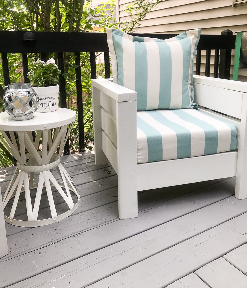 outdoor chair with blue and white striped cushion and pillow