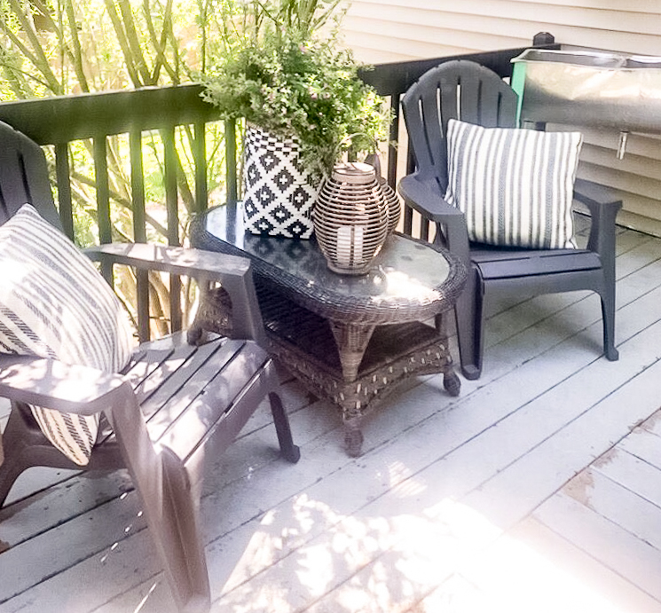 Two adirondack chairs on a deck
