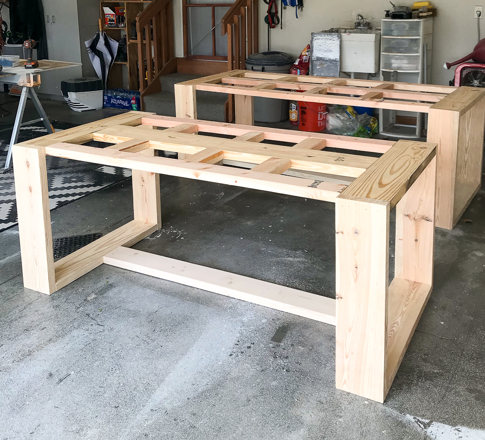 Two partially built tables in a garage