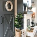 side angle of fireplace and sliding barn door with goldendoodle pup sitting pretty