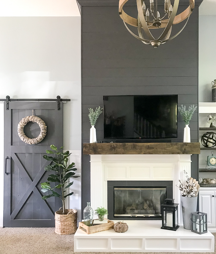 family room with fireplace and sliding barn door