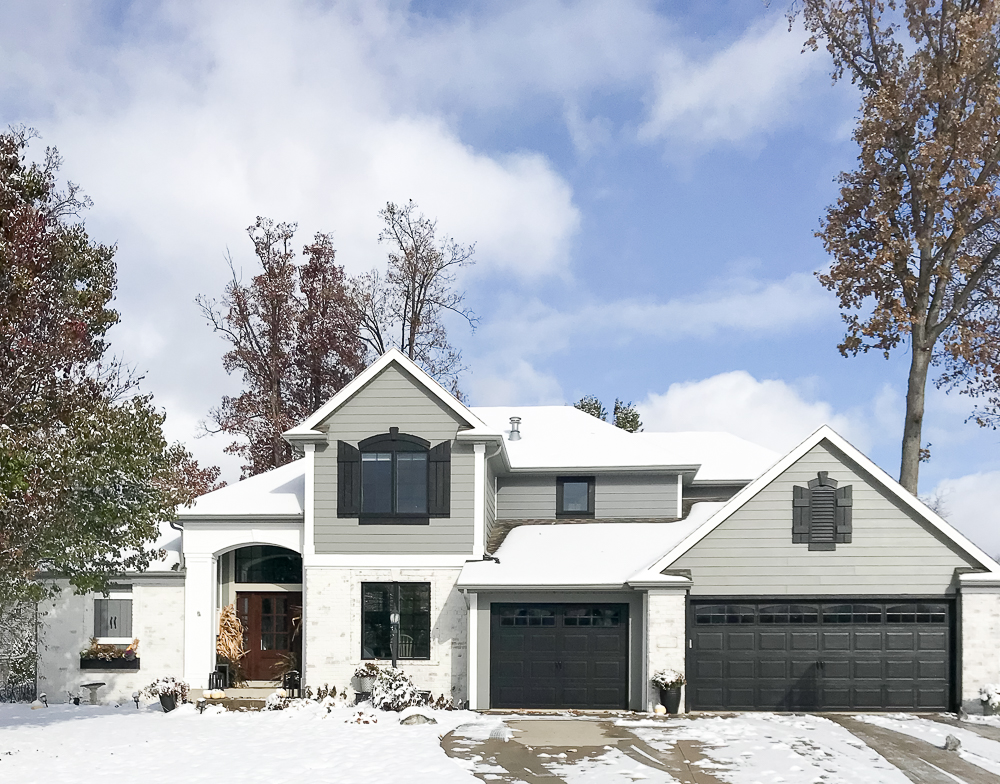 full view of home with snow