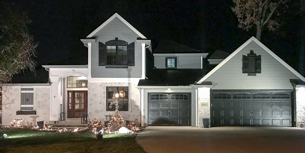 home at night with christmas lights
