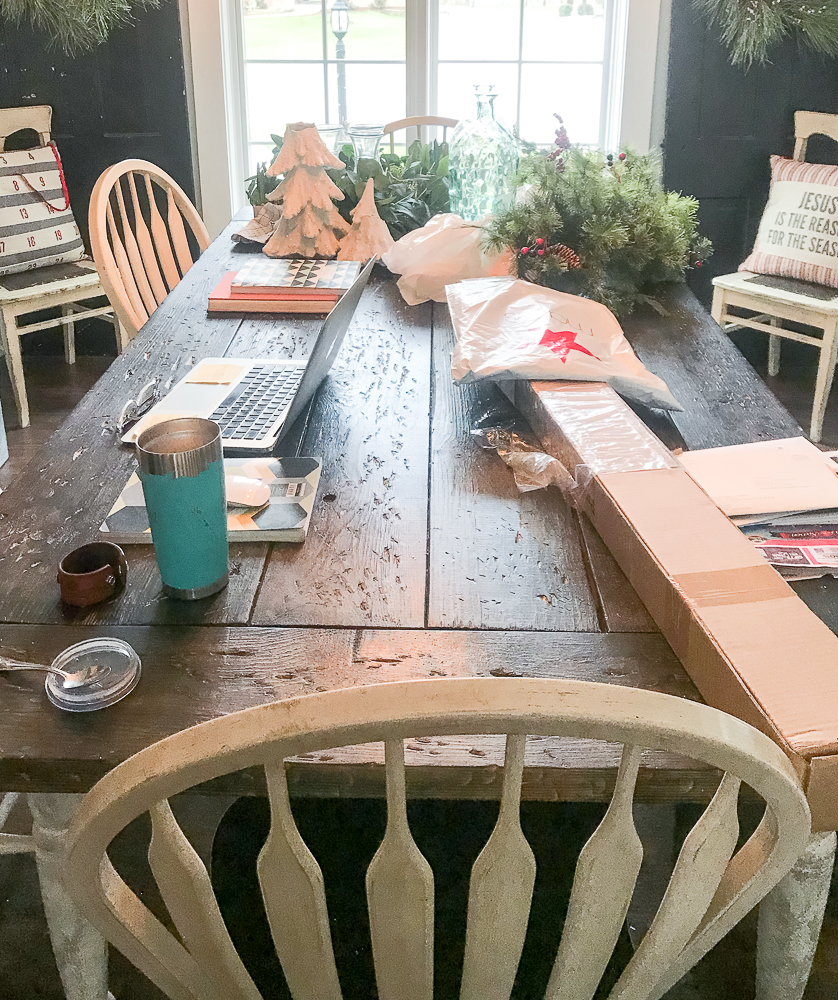 dining room table cluttered with everything christmas