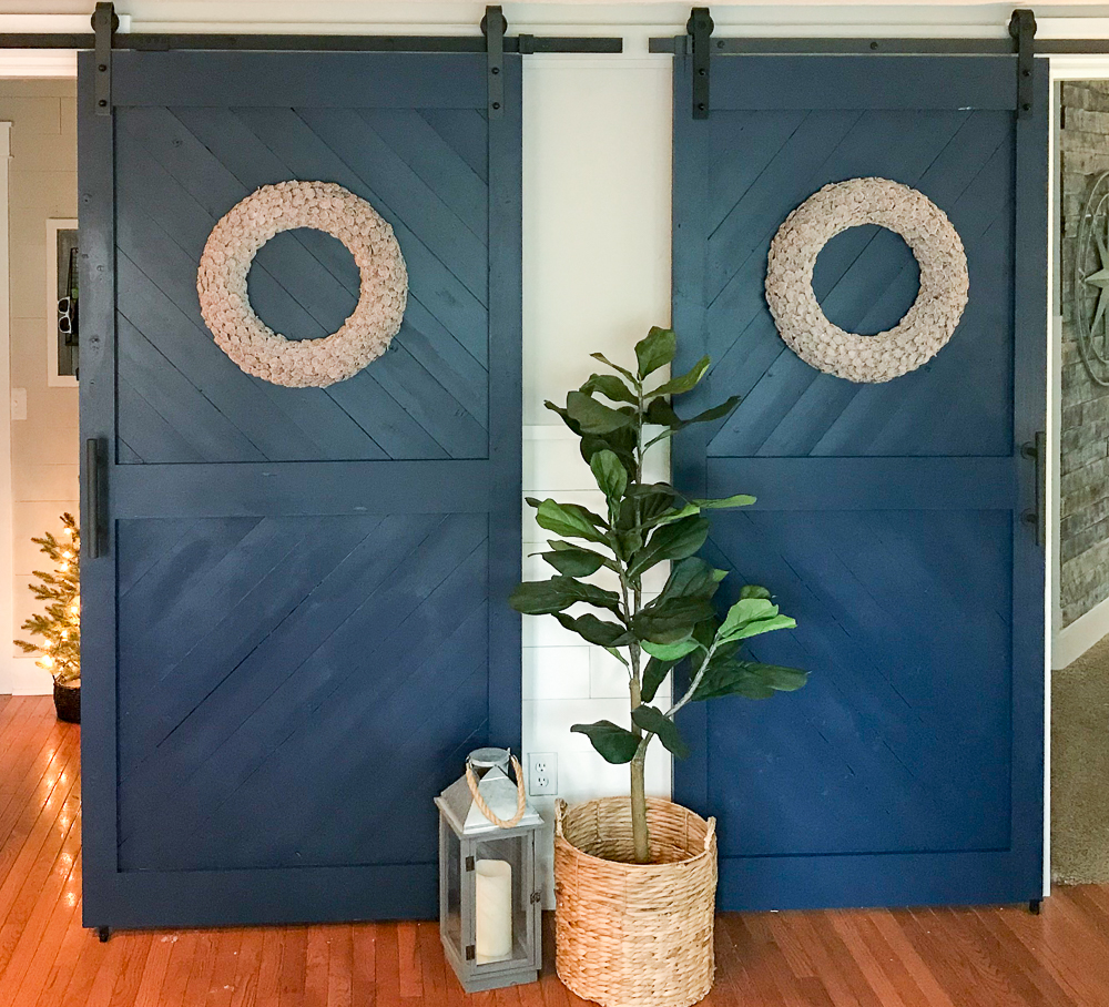 sliding barn door with fiddle fig and lantern