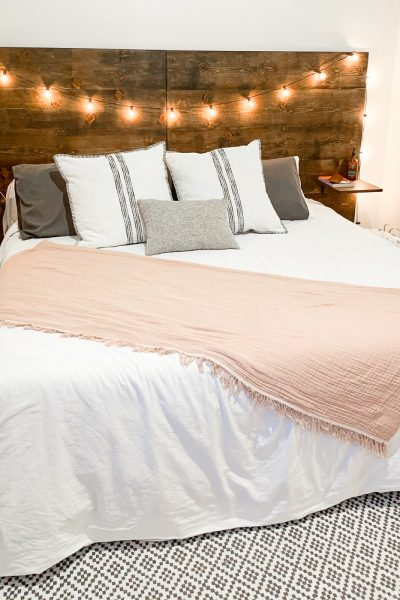 king bed with wooden headboard and lights