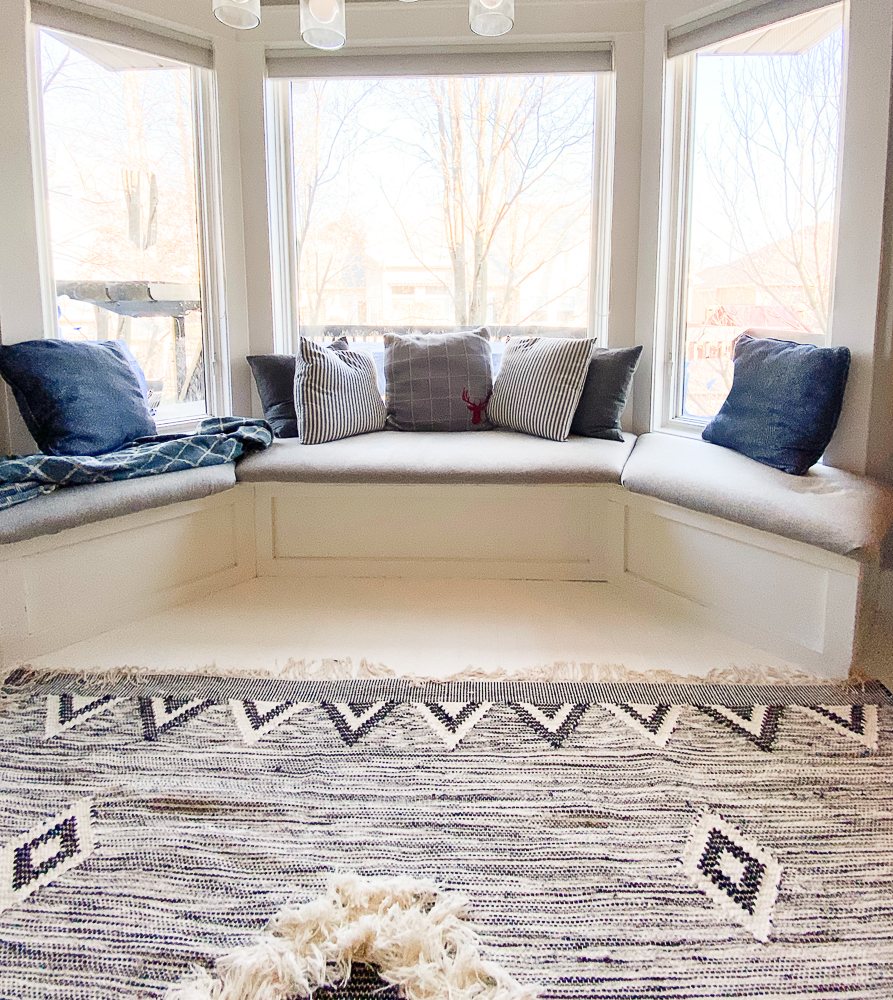 banquette area with a boho style rug