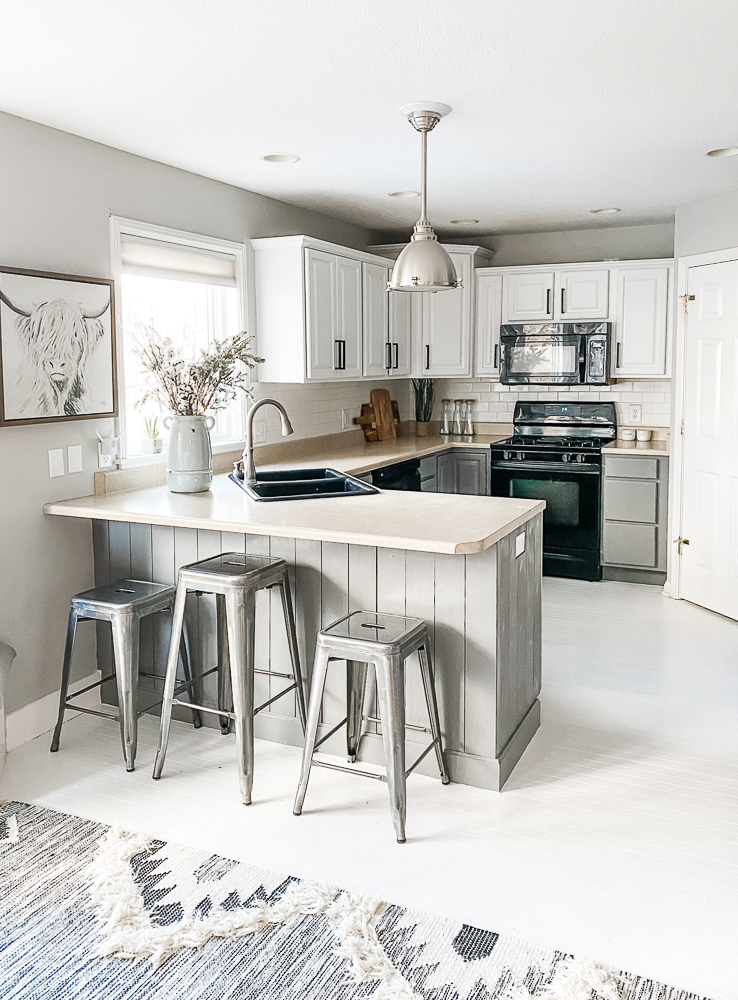 gray and white kitchen with white hardwood floors