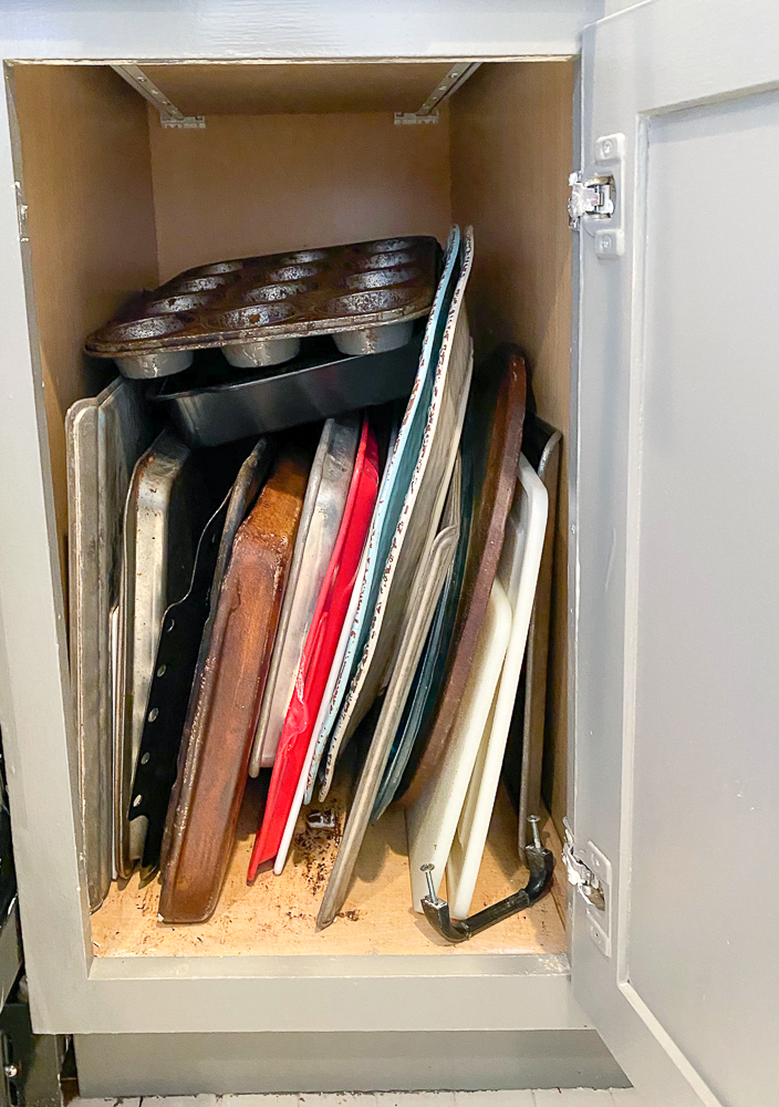 cabinet with cookie sheets