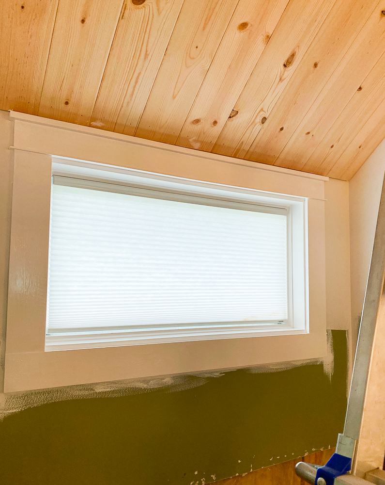 bathroom window framed with craftsman trim