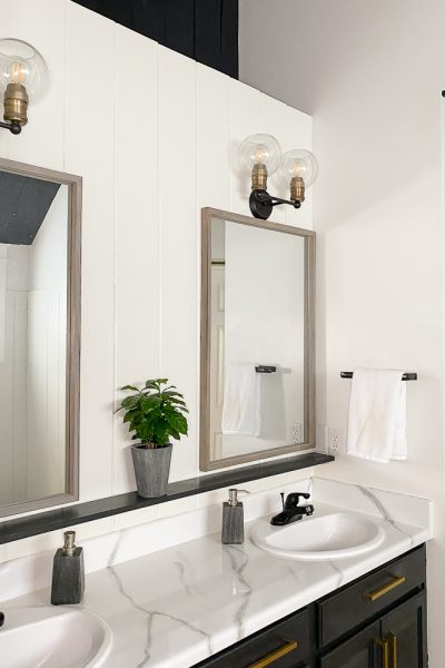 master bathroom with marble countertops