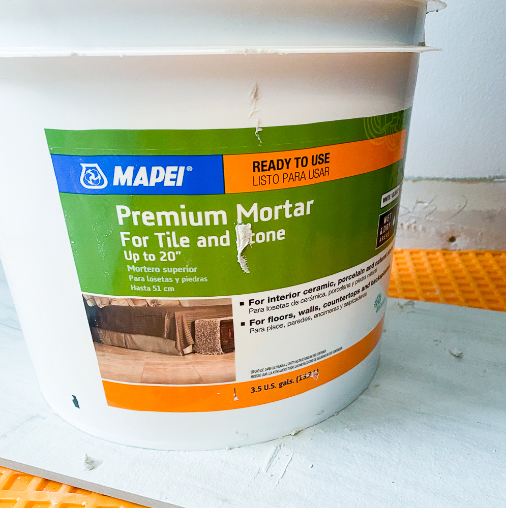 container of mortar for tiling